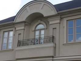 Custom windows with shaped transom and grills