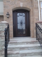 Fiberglass Arch Door with outside grill and filled Sidelites
