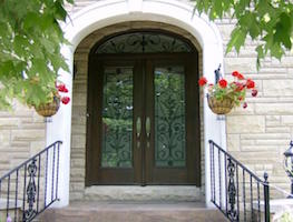 Fiberglass door with Wrought Iron in panel and transom