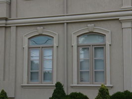 window with shaped transom with sidelites grills