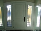 Arched Mastergrain Fiberglass 2 Panel with Custom Wrough Iron Sidelites